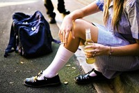 Many girls turn to alcohol early in their teens. Why?