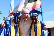 Bob with two graduates of his Restore Academy in Uganda