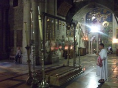 Thomas standing at the site where Jesus' body was prepared for burial. The slab is not the original (at least three slabs have lain there). It's customary to kneel and kiss the slab when entering and leaving the Church.