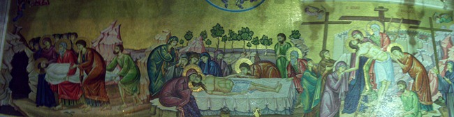 A mosaic behind the slab on which Jesus' body was prepared; this mosaic illustrates three of the major sites commemorated in the Church of the Holy Sepulcher.