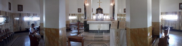 Inside the Church of the Beatitudes. Above the altar are eight stained-glass windowns, one for each beatitude.