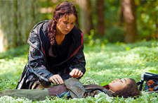 Katniss' impromptu funeral for Rue is the beginning of the End for the Capitol.